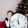 Happy boy hugs Christmas gift - Stockfoto