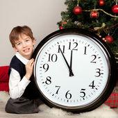 Happy boy hugs Christmas gift — Stock Photo