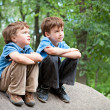 Two brothers sitting on rock — Stock Photo