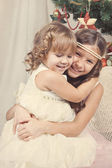 Portrait of two happy sisters, christmas — Stock Photo