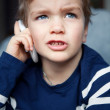 Portrait of boy with mobile phone — Stock Photo