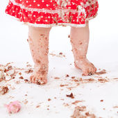 Dirty baby feet on white background — Stock Photo