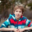 Portrait of boy with bicycle in park — Stock Photo #24764517