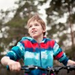 Portrait of boy with bicycle in park — Stock Photo #24764539