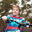 Portrait of boy with bicycle in park — Stock Photo #24764545