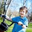 Portert boy with bicycle, outdoor — Stock Photo