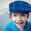 Closeup portrait of cute little boy laughing — Stock Photo #25327999