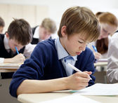 School boy struggling to finish test in class. — Stock Photo