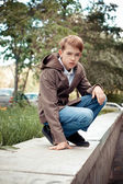 Portrait of teenager on background of city. — Stock Photo