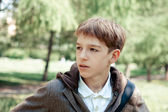 Teenager on walk in park — Stock Photo