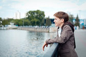 Portrait of teenager on background of river — Stock Photo