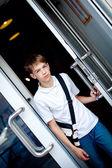 Teenager opens door of cafe — Stock Photo