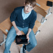 Student and tablet in classroom — Stock Photo