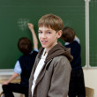 Stock Photo: Portrait of student at blackboard background