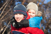 Happy children in winterwear — Stock Photo