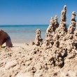 Boy making sand castle on beach — Stock Photo