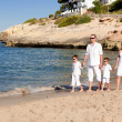 Young family with two kids on vacation — Stock Photo #28842303