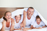 Portrait of happy family in home — Stock Photo