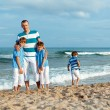 Father and sons walking on beach — Stock Photo