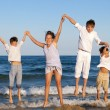 Children are jumping on beach — Stock Photo