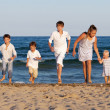 Children are running on beach — Stock Photo