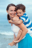Portrait of happy mother and son at sea — Stock Photo