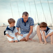 Portrait of happy family near yacht — Stock Photo