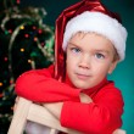 Happy small boy in santa hat — Stock Photo #32110177