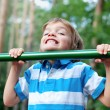 Boy playing sports outdoors — Stock Photo #32111355