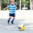 Stock Photo: Happy boy playing football