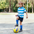 Happy boy playing football — Stock Photo