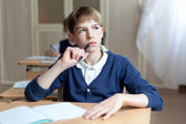 Diligent preschool sitting at desk, classroom — Stock Photo