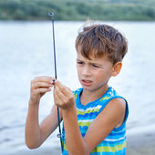 Boy fishing on river, summer — Stock Photo