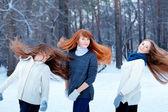 Portrait of three beautiful girls in winter park — Stock Photo