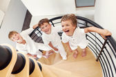 Three happy brother sitting on steps. — Stock Photo