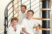 Three happy brother sitting on steps. — Foto Stock