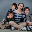 Portrait of happy mother and three sons, studio — Stock Photo #40243281