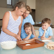 Children make cake in kitchen — Stock Photo