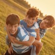 Portrait of three happy cheerful brothers — Stock Photo #51533213