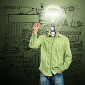 Lamp Head Businessman Writing Something — Stock Photo