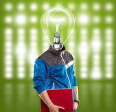ラップトップでのランプの頭の男 — ストック写真
