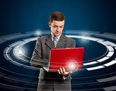 Affärsman med laptop — Stockfoto