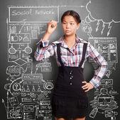 Chica asiática de la escritura — Foto de Stock