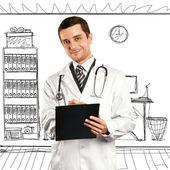 Läkare man med urklipp — Stockfoto