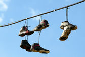 Sneakers Hanging on a Telephone Line — Stock Photo
