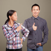 Asian Man and Girl Showing Well Done — Stock Photo