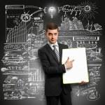 Idea Concept businessman with empty write board — Stock Photo