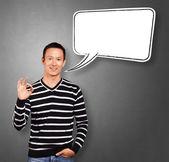 азиатские человек в полоску с речи пузырь — Стоковое фото