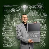 Pomysł biznesmen z otwartym laptopem w ręce — Zdjęcie stockowe