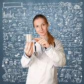 Doctor woman with cup for analysis — Stock Photo